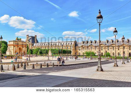 Paris, France - July 06, 2016 : Arc De Triomphe Du Carrousel (1806-1808) And People Around, Designed