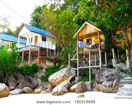The tropical beach houses in the Thailand.