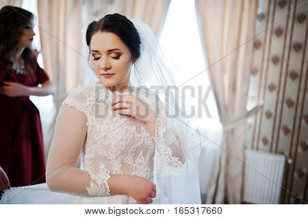 Young Brunette Bride Posed On Her Room At Wedding Day.
