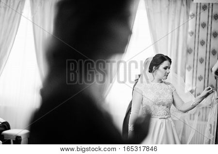Young Brunette Bride Posed On Her Room At Wedding Day. Black And White Photo