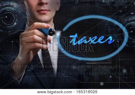 Business, Technology, Internet And Network Concept. Young Business Man Writing Word: Taxes