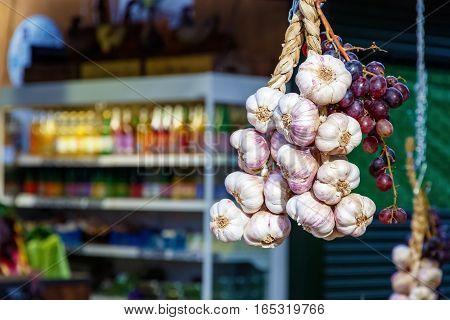 Hanging Garlics And Grapes