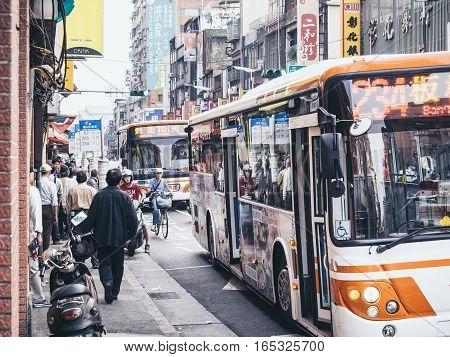 TAIPEI TAIWAN - March 19 2015 : Taipei Bus Stop Crowd People Travelling Local Transportation Bus City guide
