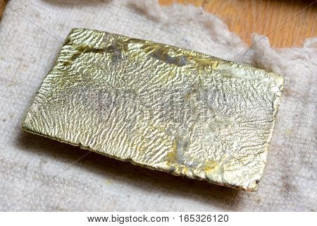 Shiny yellow raw golden ingot recently produced