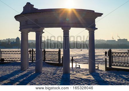 architecture arch against the sky on the lake in winter