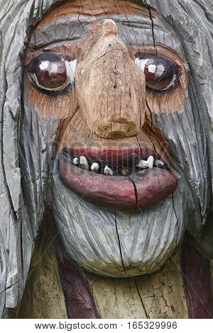 Norwegian carved wooden face detail troll. Scandinavian folklore. Norway. Vertical
