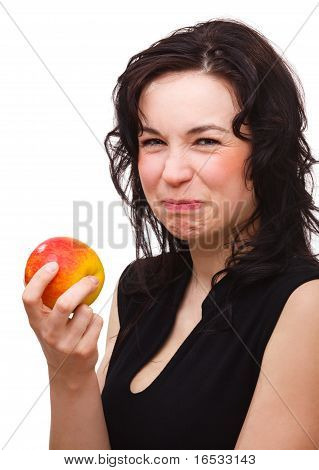 Woman Is Making Sour Face After Biting An Apple