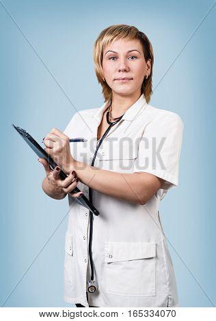 Smiling medical doctor holding a folder over blue background