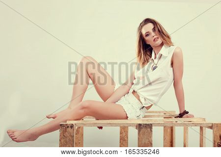 Model In White Mini Shorts And Shirt Posing In Studio