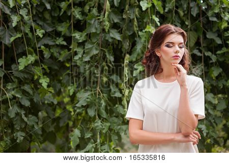 Sensual Woman In White Shirt Posing Outside In Park