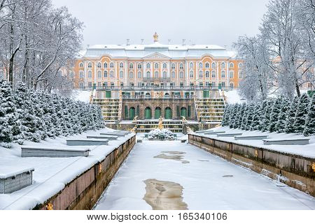 PETERHOF, SAINT - PETERSBURG, RUSSIA - JANUARY 15, 2017: View of The Grand Cascade and The Grand Palace in The State Museum Preserve Peterhof. The Lower Park in winter period.