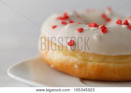 Single elegant donuts on plate. Closeup view
