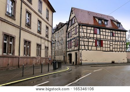 Street with authentic ancient half-timbered houses in Colmar, France.