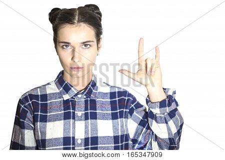 Girl showing rock symbol. Beautiful girl. Beautiful portrait of a girl in a plaid shirt over a white background. Space for text