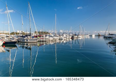 Boats and yachts moored up in a marina