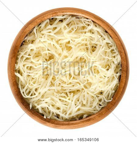 Prepared horseradish in wooden bowl. Grated roots of Armoracia rusticana. Fresh white spice with intense flavor, irritating eyes. Isolated macro food photo close up from above on white background.