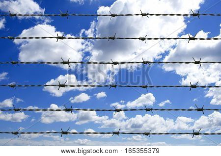 Barbed wire and beautiful clouds sky background
