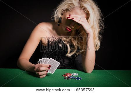 Woman being depressed and losing poker game