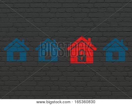 Security concept: row of Painted blue home icons around red home icon on Black Brick wall background