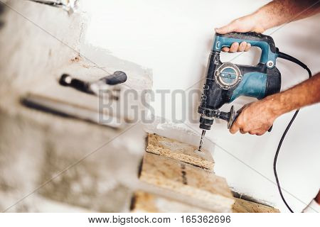 Precise Wood Worker Using Professional Drill Press For Making Holes In Wood Boards And Concrete