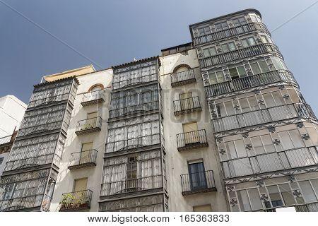 Jaen (Andalucia Spain): facade of building with typical verandas.