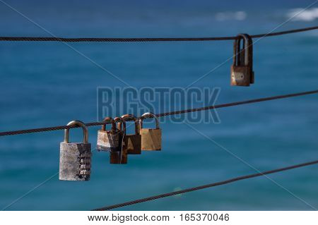 Closed padlocks on iron rope represent love and security