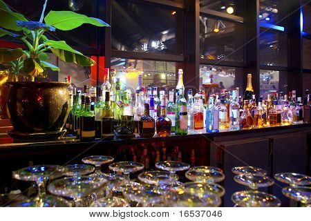 Assorted colorful bottles of alcoholic drinks in a night-club