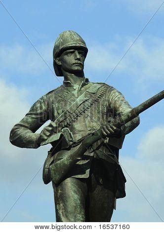 Military Memorial. Bronze soldier, blue sky.
