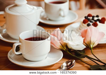 Traditional Dessert Pavlova Cake With Fresh Berries And Tea