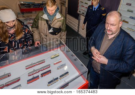 Kolomna, Russia - January 03, 2017: Guide of the museum tram miniatures displays exhibits to visitors. Kolomna - the birthplace of the first electric tram in Russia.