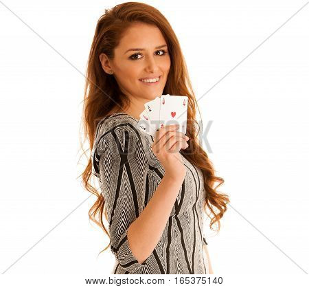 Beautiful Brunette Holding Four Aces As A Sign For Poker Game, Gambling And Casino