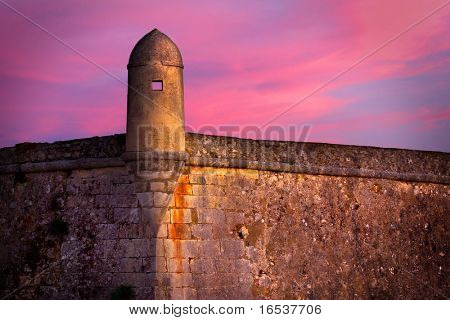 Detail of an old military fort with sentry box at dusk