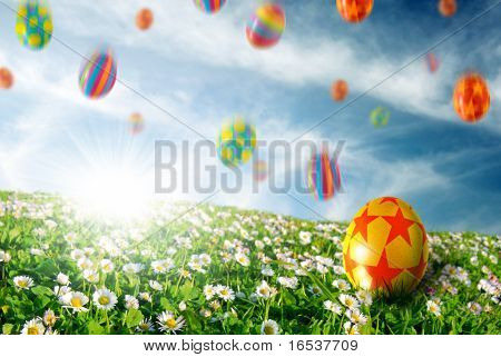Colorful Easter eggs falling down on a flower field