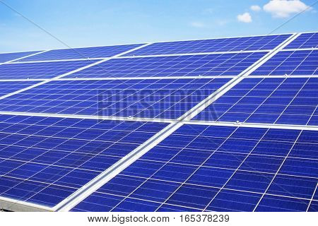 Solar panels with the blue sky at a daytime.