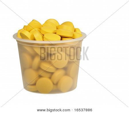 Medicine Cup Of Pills Isolated