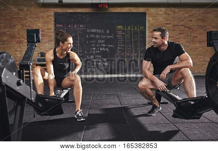 Young Athletic Sportspeople Training On Body Builders