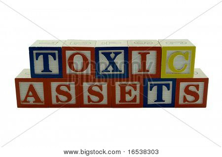 A series of Wooden Alphabet Blocks Spelling Toxic Assets