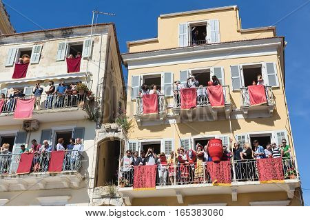 CORFU, GREECE - APRIL 30, 2016: Corfians throw clay pots from windows and balconies on Holy Saturday to celebrate the Resurrection of Christ. Easter pot smashing.