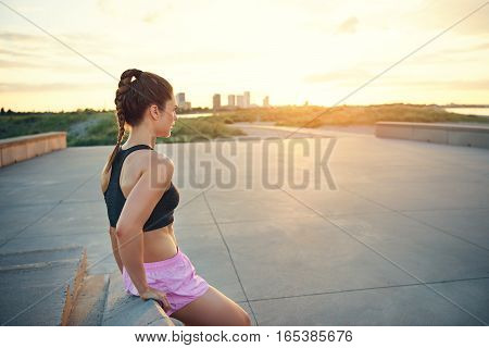 Young Female Athlete Leaning On Bench