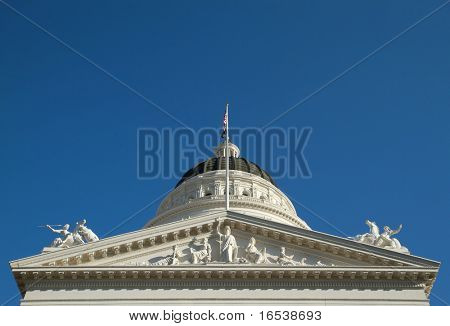 Closeup of California state capitol building sculptures of Minerva, the dome, and the two horses
