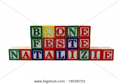 Green, Red, and blue wood Toy alphabet blocks spelling Buone Festa Natalizie or Merry Christmas in Italian