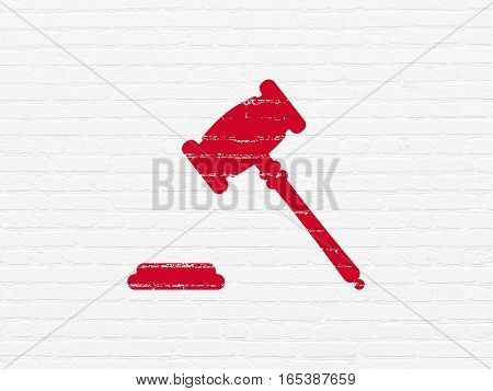 Law concept: Painted red Gavel icon on White Brick wall background