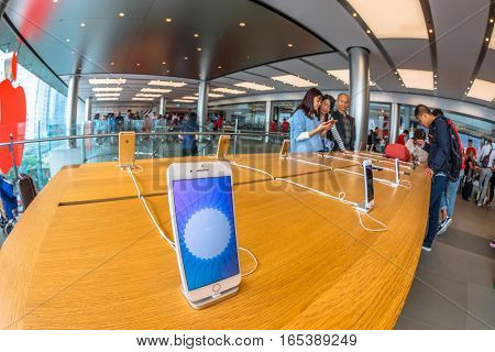 Hong Kong, China - December 4, 2016: close up mobile smath phone inside Apple store, IFC Mall, Central District. Apple is world leader in consumer electronics, computers and mobiles. Fish-eye view.