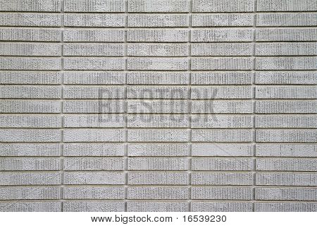 Large wall of white painted bricks taken up close