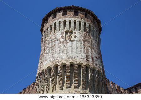 Tower Of Medieval Italian Castle On Blue Sky