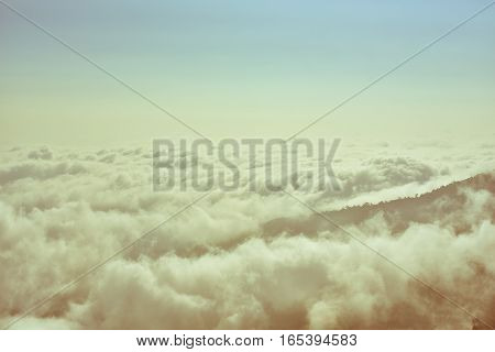 warm white puffy clouds on vintage tone
