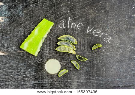 Aloe Vera Pieces And Aloe Gel In The Glass On An Old Dark Wood Background Organic Cosmetics Concept