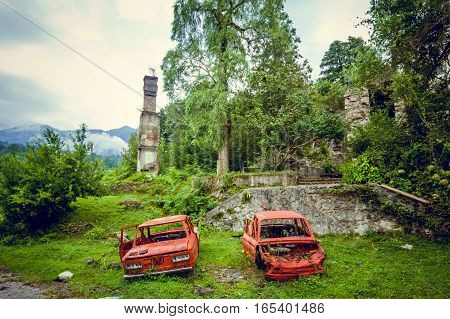 Abandoned mining ghost-town Jantuha, Abkhazia. Destroyed empty houses, the remains of the cars, remnant of The Georgian-Abkhazian war