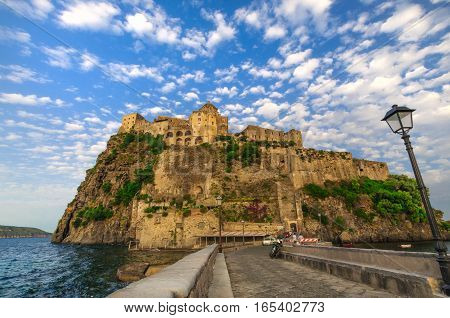 Beautifil view on Aragonese castle at sunset, Ischia, Italy