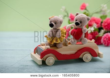 Valentines Day. Love heart. Couple Teddy Bears on the car. Handmade toys. An offer of marriage. Vintage retro romantic style. Family, wedding and friendship